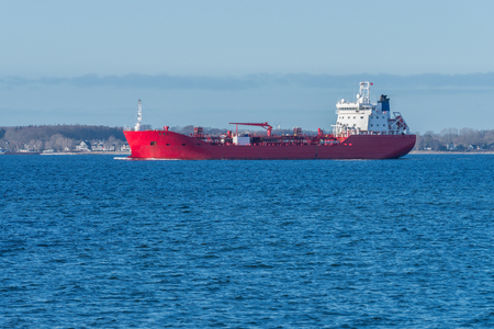 image of red cargo barge at sea