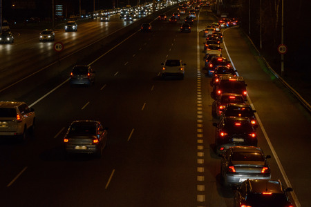 image of car traffic at night on the road