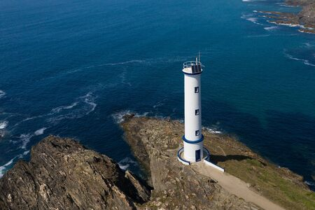 image of lighthouse on a cliff on the background of a beautiful seascape top view