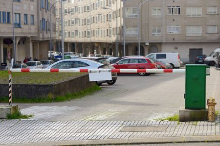 view of barrier at the entrance to a car parking on a street in the city Archivio Fotografico