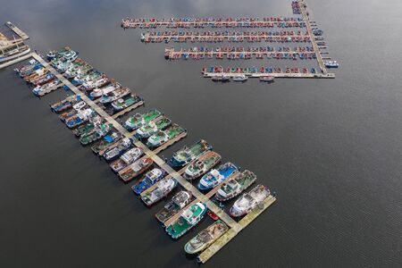 image of fishing boats on the pier in the port aerial view