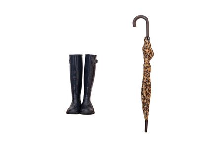 black rubber boots and folded leopard umbrella isolated on white background Stock Photo