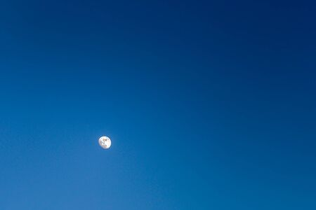 brightly lit moon in a cloudless dark blue sky, nature, landscape