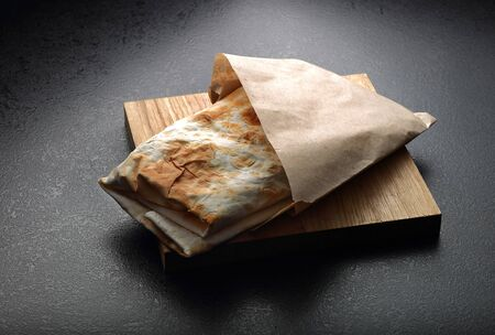 quick snack: Lavash  traditional Armenian bread. Black background Stock Photo