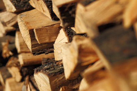 firewood background: Stack of dry chopped firewood. Background of a pile Stock Photo