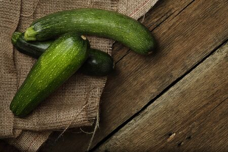 Zucchini on wooden background. Top view. Stock Photo