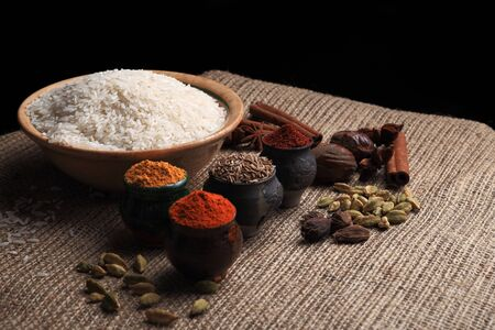 Rice and assorted spices on the table. Basic raw for asian cuisine