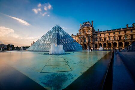 Paris, France - OCT 2016. Pyramid and fountain of the Louvre Art Museum, famous architectural landmark. Popular touristic places and travel destination in Europe. Holiday and tourism concept Editorial