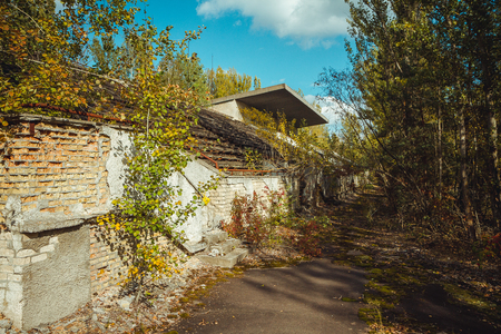 Old football stadium in Chornobyl exclusion zone. Radioactive zone in Pripyat city - abandoned ghost town. Chernobyl history of catastrophe