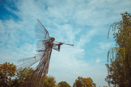 Memorial complex Star Wormwood. Sculpture Trumpeting Angel in Chornobyl exclusion zone. Radioactive zone in Pripyat city - abandoned ghost town Stock Photo