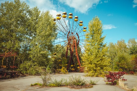 Abandoned amusement park in the city center of Prypiat in Chornobyl exclusion zone. Radioactive zone in Pripyat city - abandoned ghost town. Chernobyl history of catastrophe