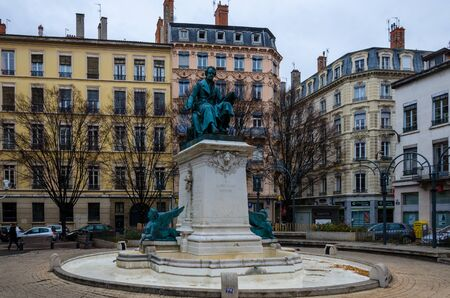 ampere: Statue of Ampere on the fontain in autumn, Lyon, France