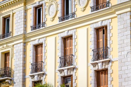 cote d'azur: Facade of a house with balconies on the south of France, Cote dAzur Stock Photo