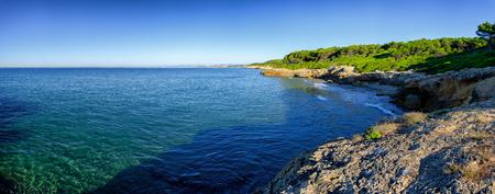 harbors: Panoramic view on multiple rocky harbors near Tarragona, summer Spain