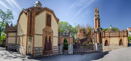 Scaly facade of Guell constructions in Pedralbes park, Barcelona summer Spain