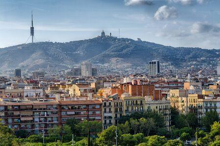 montjuic: Barcelona cityscape and Monserrat mountain in sunset light, summer Spain