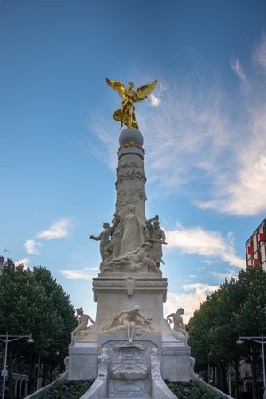 angels fountain: Sube fountain with golden angel and statues in Reims, France Stock Photo