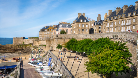 The buildings, catamarans and boats on beach Bon Secours in Saint-Malo, France