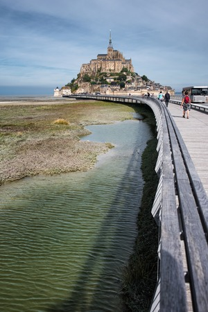 Panoramic vertical view on Mont-Saint-Michel and a road to Abbey , France Stock Photo