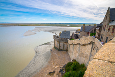 Great stone wall of Mont-Saint-Michel and the bay, France Stock Photo