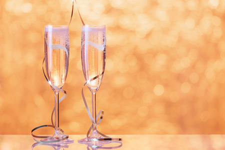 degustation: Two champagne glasses wrapped with ribbon as a decoration