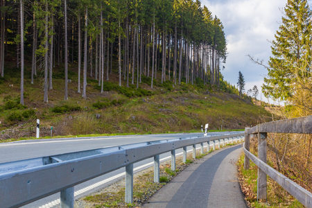 A winding road through the Harz National Park, Lower Saxony, Ger
