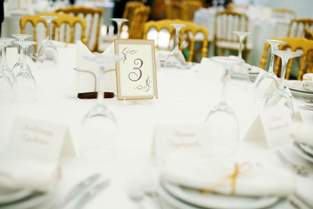 a marriage meeting: Elegant tables  set up for a wedding banquet Stock Photo