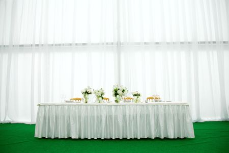 set up: Elegant tables and chairs set up for a wedding banquet