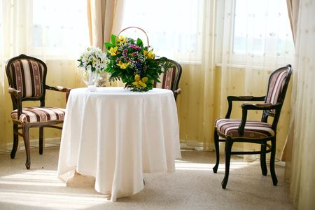 A view of a  banquet table  and a colorful flower centerpiece. Stock Photo - 5963144