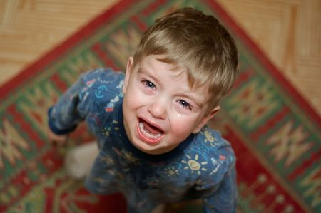 crying boy: Crying little boy asks his mothers candy.  Stock Photo