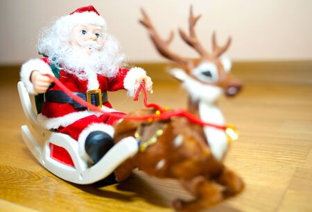 Santa Claus and his faithful friend go deer distributed gifts to children  photo