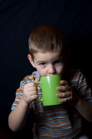 The boy drinks from morning warm milk for health Imagens