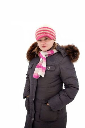subordinated: young woman warmly and wrapped in a thick winter jacket.  Stock Photo