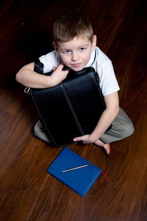 A boy imagines himself a businessman, a serious attitude