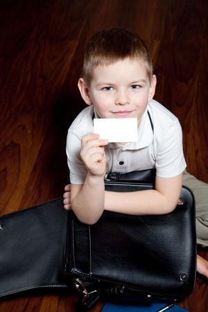 imagines: A boy imagines himself a businessman, a serious attitude  Stock Photo
