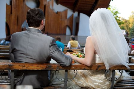 Newlyweds in a park on a bench photo