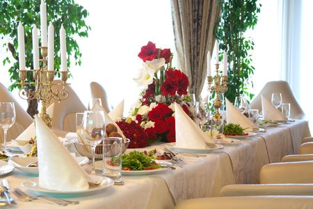 Tables set and salad served for a wedding reception.  photo