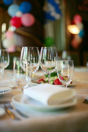 a marriage meeting: Tableware, preparing to feast. Balloons in the background. Stock Photo