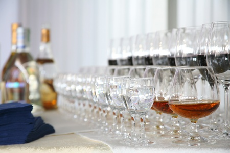 liqueur labels: On a table stand with wine glasses, vodka, champagne and cognac