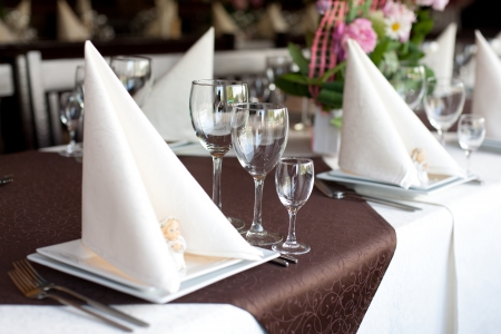 hotel service: Table with fish dishes and served silverware