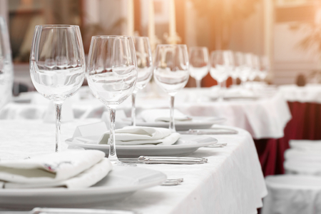 restaurant table: Tables set and salad served for a wedding reception.