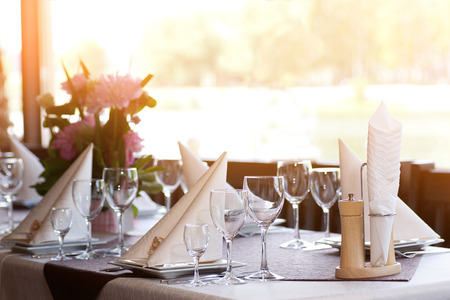 dinner hall: Tables set and salad served for a wedding reception.