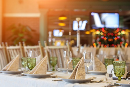 restaurant tables: Tables set and salad served for a wedding reception.