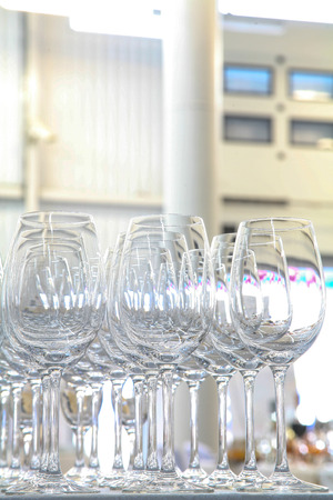 Empty glasses on the table in a large hangar