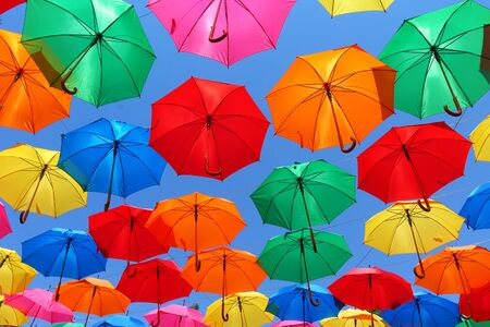 colored umbrellas on a background of blue sky 写真素材