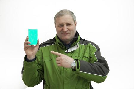 careerist: Middle-aged man in a ski jacket advertises goods
