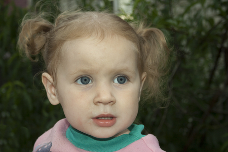 gasping: Little blond girl with surprised looks. Stock Photo