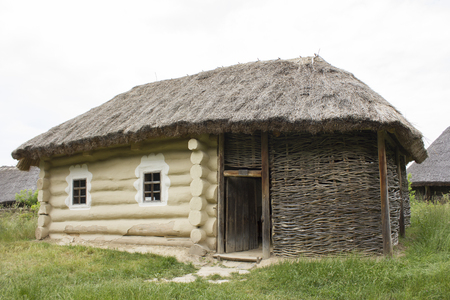 An old wooden house with thatched roof Stock Photo