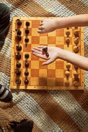 two minds: two boys are playing chess. the boys shake hands with each other Stock Photo