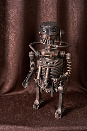 collect: old mechanical robot on a brown background